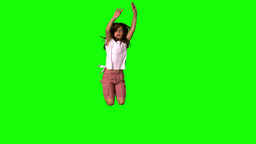 Happy girl jumping up on green screen Footage