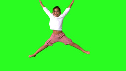 Little girl jumping on green screen Footage