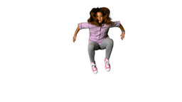 Happy little girl jumping on white background Footage