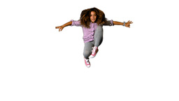 Happy little girl jumping up and down on white background Stock Video Footage