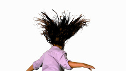 Girl jumping and spinning on white background Footage