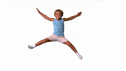 Boy jumping with limbs outstretched on white backg Footage