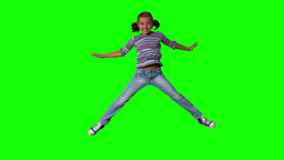 Happy girl jumping up and down on a green screen Footage