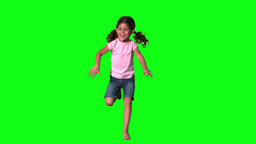 Cute little girl jumping on green screen Footage