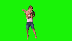 Cute little girl jumping and catching teddy on gre Footage