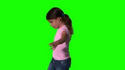 Cute little girl spinning around on green screen Footage