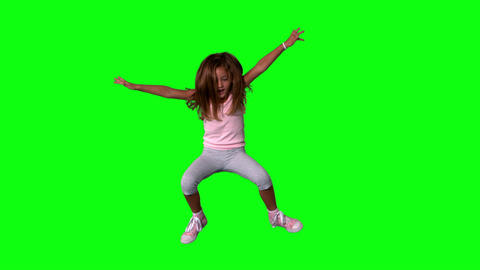Cute little girl jumping with limbs outstretched o Stock Video Footage