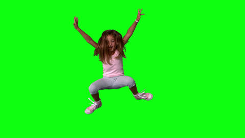 Cute little girl jumping with limbs outstretched o Footage