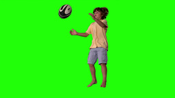 Little boy jumping and catching rugby ball on gree Footage