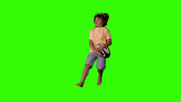Little boy jumping up and catching rugby ball on g Stock Video Footage