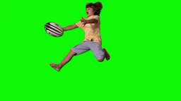 Little boy jumping up and catching a rugby ball on green... Stock Video Footage