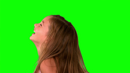 Close up of little girl laughing and turning on green screen Stock Video Footage
