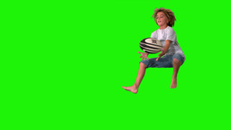 Boy jumping up to catch rugby ball on green screen Footage