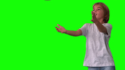 Boy jumping up to catch rugby ball on green screen Stock Video Footage