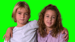 Siblings smiling on green screen Stock Video Footage