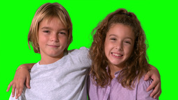 Siblings smiling on green screen Footage