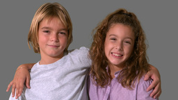 Siblings smiling on grey background Footage