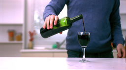 Man pouring red wine into a glass Footage