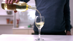 Man pouring white wine into a glass Stock Video Footage