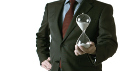 Man holding an hourglass Stock Video Footage