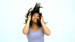 Smiling woman jumping and listening music Footage
