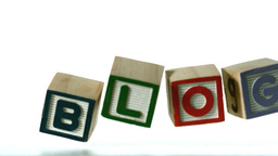 Row of blocks spelling Blog falling over Footage