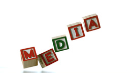 Blocks spelling media dropping down Stock Video Footage