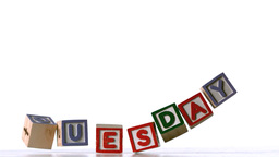 Blocks spelling tuesday falling over Stock Video Footage