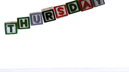 Blocks spelling thursday falling over Stock Video Footage