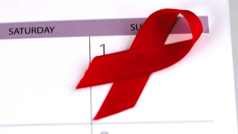 Red ribbon falling on a calendar Footage