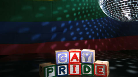 Disco ball spinning above gay pride blocks Stock Video Footage