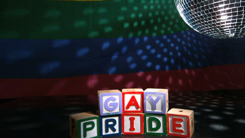 Disco Ball Spinning Above Gay Pride Blocks stock footage
