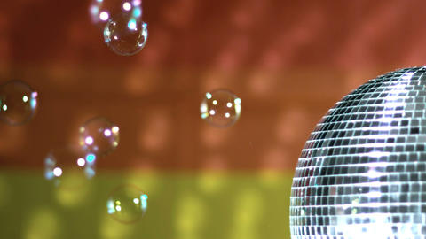 Shiny disco ball spinning with floating bubbles ag Stock Video Footage
