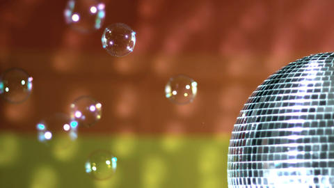 Shiny disco ball spinning with floating bubbles ag Footage