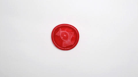 Red condom Stock Video Footage