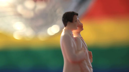 Gay groom cake toppers revolving with disco ball Stock Video Footage