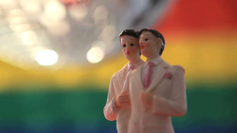 Gay groom cake toppers revolving with disco ball Footage