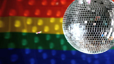 Disco ball revolving against gay pride flag Stock Video Footage