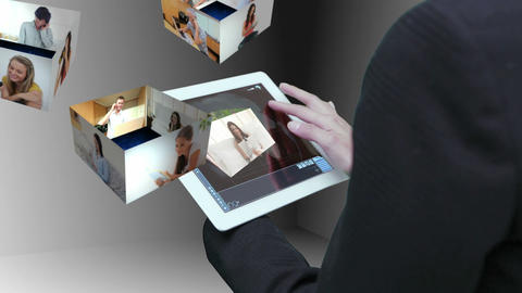 Businesswoman using tablet to view montage of lifestyle clips Animation