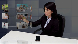 Businesswoman sitting at desk and scrolling throug Animation