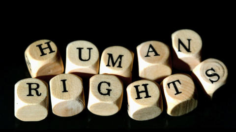Human rights dice coming together Stock Video Footage