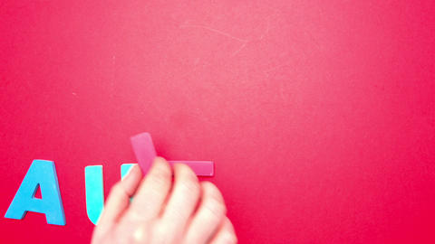 Autism spelled out in colourful letters with aware Stock Video Footage
