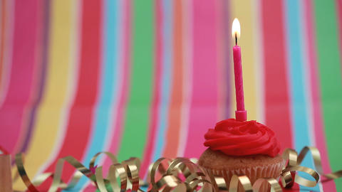 Candle on birthday cupcake blown out Footage