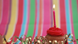 Candle on birthday cupcake blown out Stock Video Footage