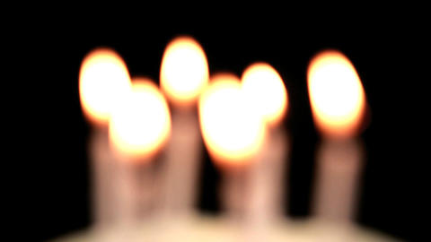 Focus on birthday candles being blown out Stock Video Footage