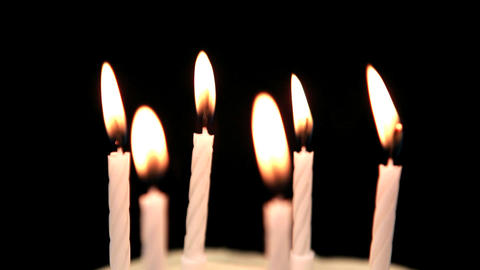 Focus on birthday candles being blown out Footage