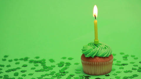 St patricks day cupcake with shamrock confetti Stock Video Footage