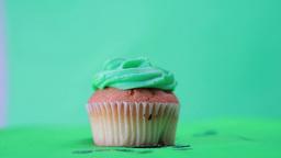 St patricks day cupcake spinning around with shamr Footage