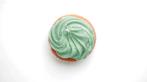 St patricks day cupcake turning with green shamroc Stock Video Footage