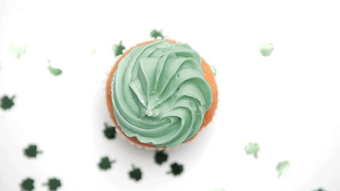 St patricks day cupcake turning with green shamroc Footage